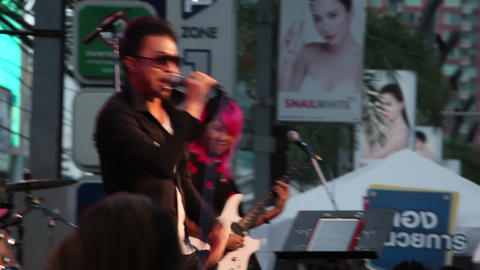 Be Peerapat And Music Band Performs At Public Concert On Street stock footage