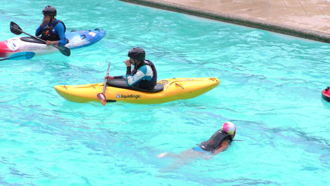 Group of young people with kayaks in Santa Ana public pool ready for summer cont Footage