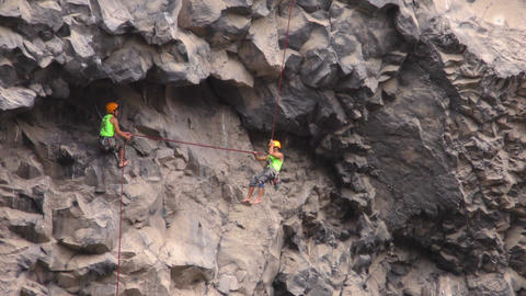 Rock climbers helping each other during Basalt of Tungurahua competition Footage