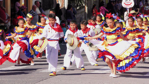 Group of childrens dressed up in traditional costumes dancing on the streets of  Footage