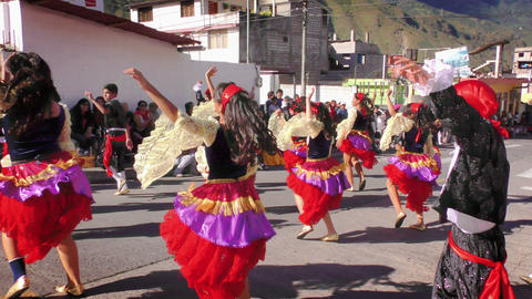 Group of dynamic dancers on the streets of Banos de Agua Santa Footage