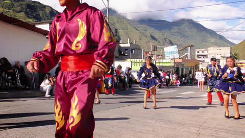 Dancers In Colorful Traditional Costumes Dancing On The Streets Of Banos For Footage