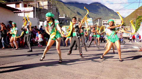 Dancing group on the streets of Banos during 100th anniversary of Sagrado Corazo Footage