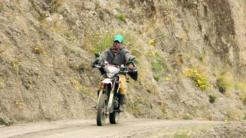 Quechua peasant riding a Chinese unbranded motorcycle Footage