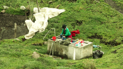 Manual laundry by peasant woman in Ecuador Footage