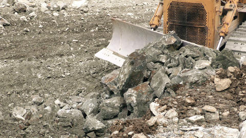 Bulldozer moving large quantity of loose rocks Footage
