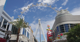 Steadicam Las Vegas Shopping Center With High Roller On A Background stock footage