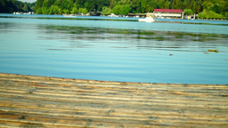 Wooden Pier And Motor Boat Footage