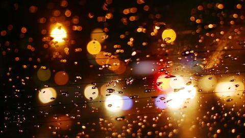 traffic bokeh lights in rainy night city Footage