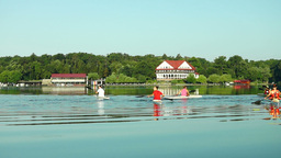 Young People Kayaking In The Lake. End Of Race Footage