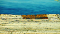 Wet Wooden Pier And Indigo Water, Tilt. Holiday Landscape Footage