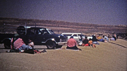 1972: Navajo Native American southwest round housing and people selling jewelry Footage