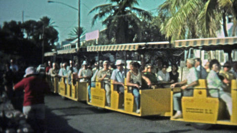 1973: Tourist Train Takes Drunks And Old People Down The Main Strip Of The City stock footage