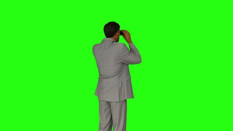 Businessman looking through his binoculars Footage