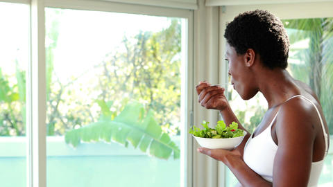Pregnant woman eating a salad at home Footage