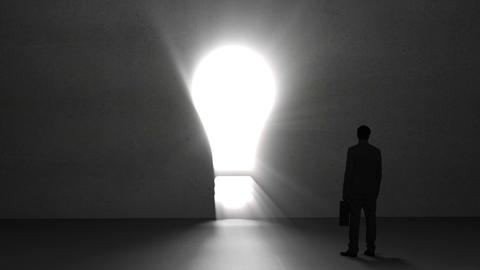 Businessman looking at giant light bulb Animation