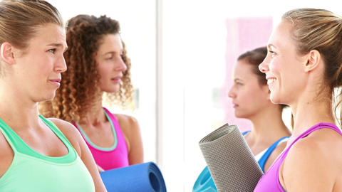 Smiling athletic women discussing together Footage