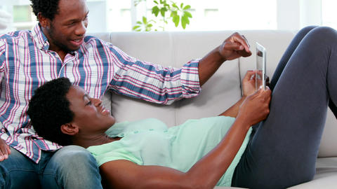 Cute couple looking at ultrasound scan of baby Footage