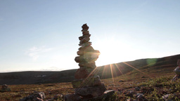 Stack of stones and sunny sky Footage