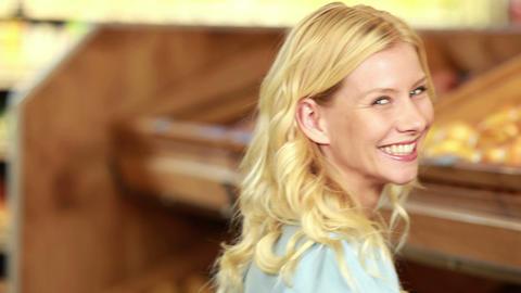 Smiling blonde choosing apple Footage