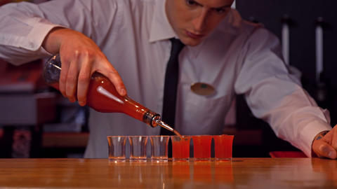 Bartender pouring shots on counter Footage