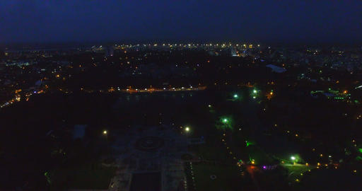 Night aerial of city and people's park and square Footage