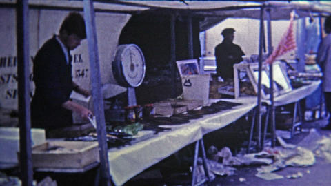 1969: Outdoor market selling dried fish and other foods and goods Footage
