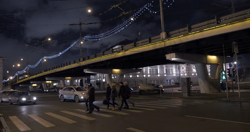 Pedestrians crossing the road on green light Footage