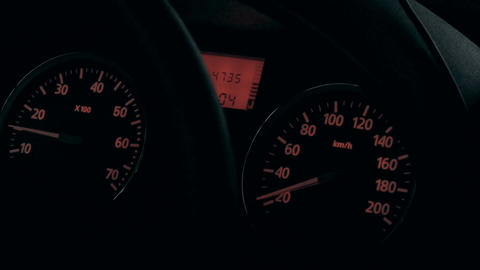 Car dashboard with low speed shown Live Action