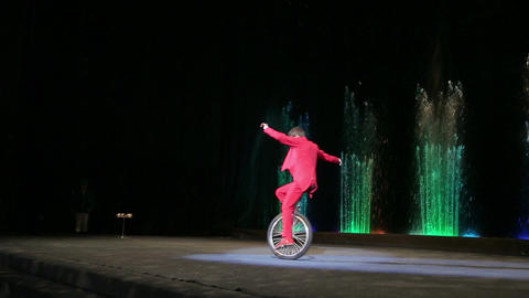 Male Circus Artist Riding a Monocycle during Performance Footage