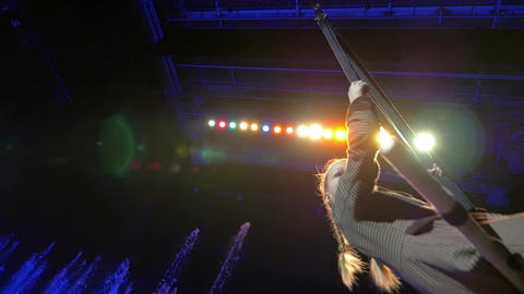 Girl swinging on the trapeze during performance Footage