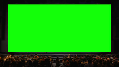 People in the auditorium with chroma key screen Live Action