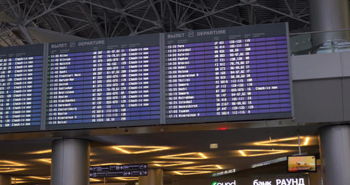 Digital flight schedule at the airport Live Action