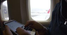 Internet surfing on cell phone before flight Footage