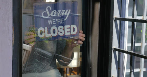 Woman changing sign from closed to open Footage