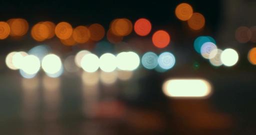 Defocus of city traffic at night Footage