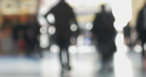 People walking indoor against bright light Footage
