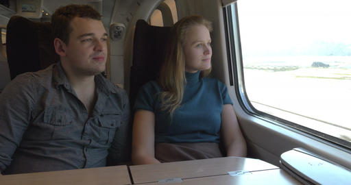 Two passengers looking out the train window Footage