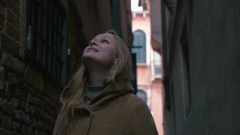 Woman in alleyway looking around Footage