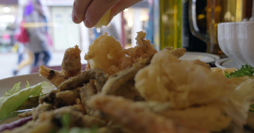 Squeezing the Lemon Wedge on Seafood Footage