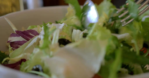 Tossing Greek salad before eating Footage