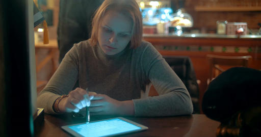 Woman Using Tablet PC with Stylus in Cafe Live Action