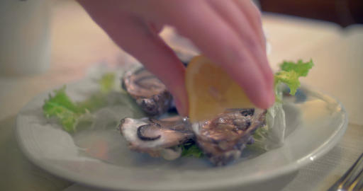 Pouring lemon juice on oysters Footage