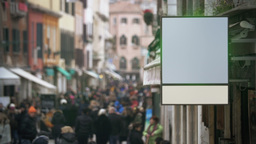 Blank banner hanging in crowded street Footage