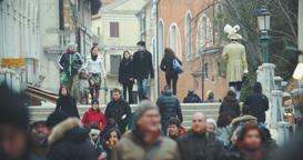 Venetian street view with people walking across the bridge Footage