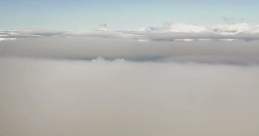 Aerial view to city through the clouds Footage
