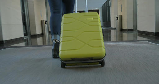 Woman tourist with suitcase arriving in the hotel Footage
