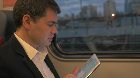 Man with tablet computer on business trip Footage