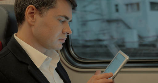 Young businessman chatting on pad in the train Footage