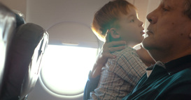 Boy and his grandmother hugging in the plane Footage